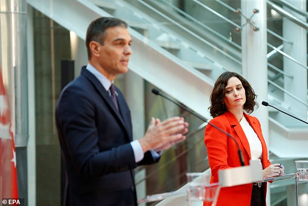 Following a meeting in Madrid last month, Spanish Prime Minister Sanchez (left) speaks at a bilateral press conference (right) with Madrid regional leader Isabel Diaz Ayuzo