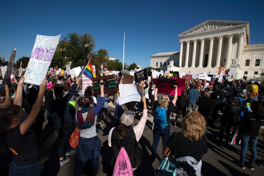 Women march in front of the US Supreme Court in Washington