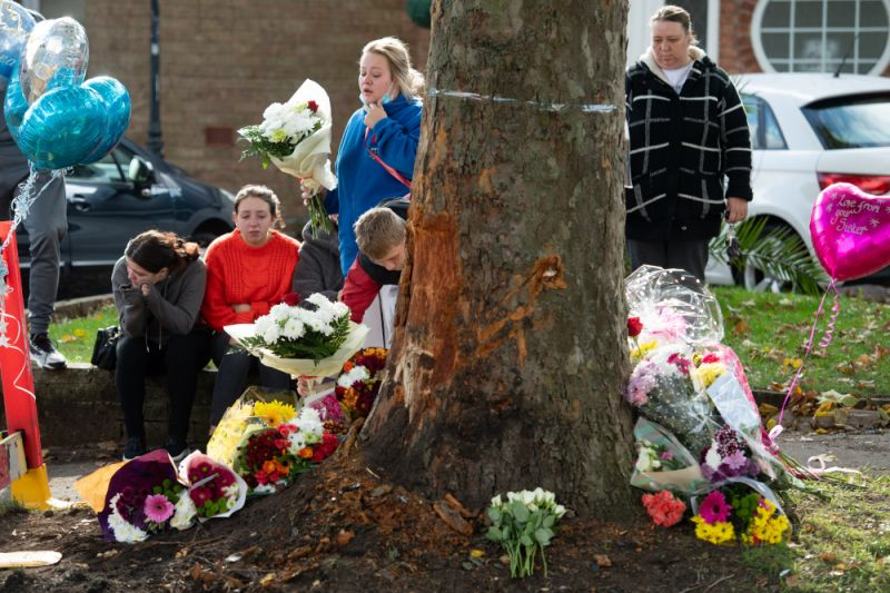 Photo of mourners at the scene of a horrific crash on Bromley Lane in Kingswinford, near Dudley.