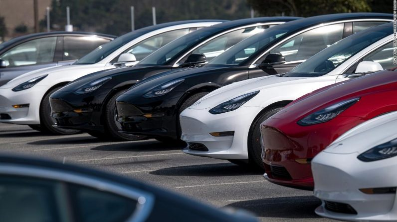 Hours after the company recorded a record profit, Tesla's stock is expected to sell half a million cars this year.