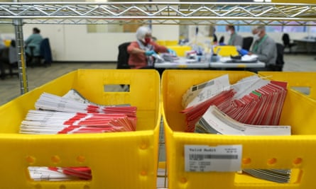 Mail ballot boxes are waiting to be processed by ballot at King County election headquarters in Renton, Washington.