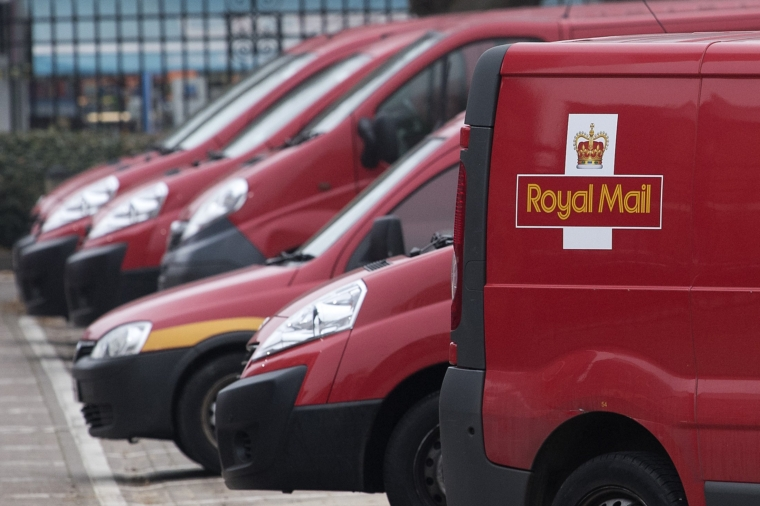 (FILES) This mail photo, taken on December 19, 2016, shows Royal Mail delivery vans parked at the Mount Pleasant sorting office in London.  - Royal Mail, the British mail operator that has been sending mail for over 500 years, announced plans on 21 October 2020 to collect parcels from homes in the UK following the outbreak.  (Photo by Justin Dollis / AFP) (Photo by Justin Dollis / AFP via Getty Images)