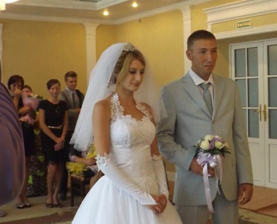 Alexander Yakunin, 30, and his 25-year-old wife Victoria on their wedding day.