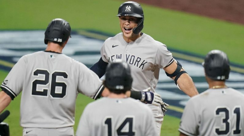 Giancarlo Stanton stretches home run tears with slam in ninth inning
