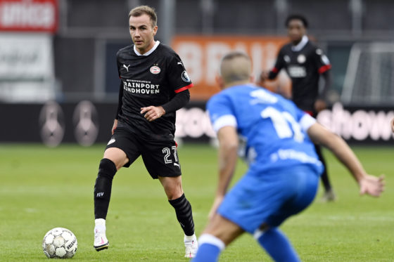Mario Gotze with the ball for PSV EIndhoven against an unidentified PEC Zwolle defender