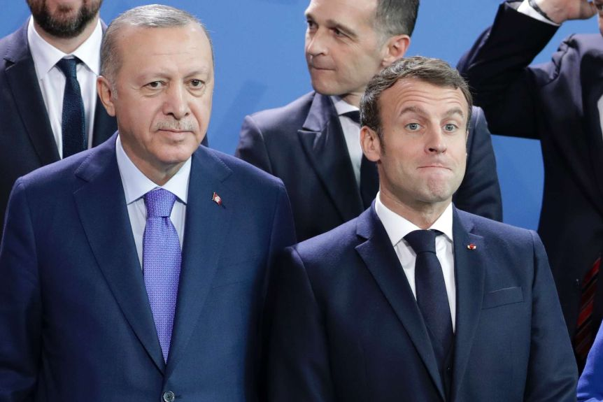 Turkish President Recep Tayyip Erdogan, left and French President Emmanuel Macron are lined up in front of suitable men.