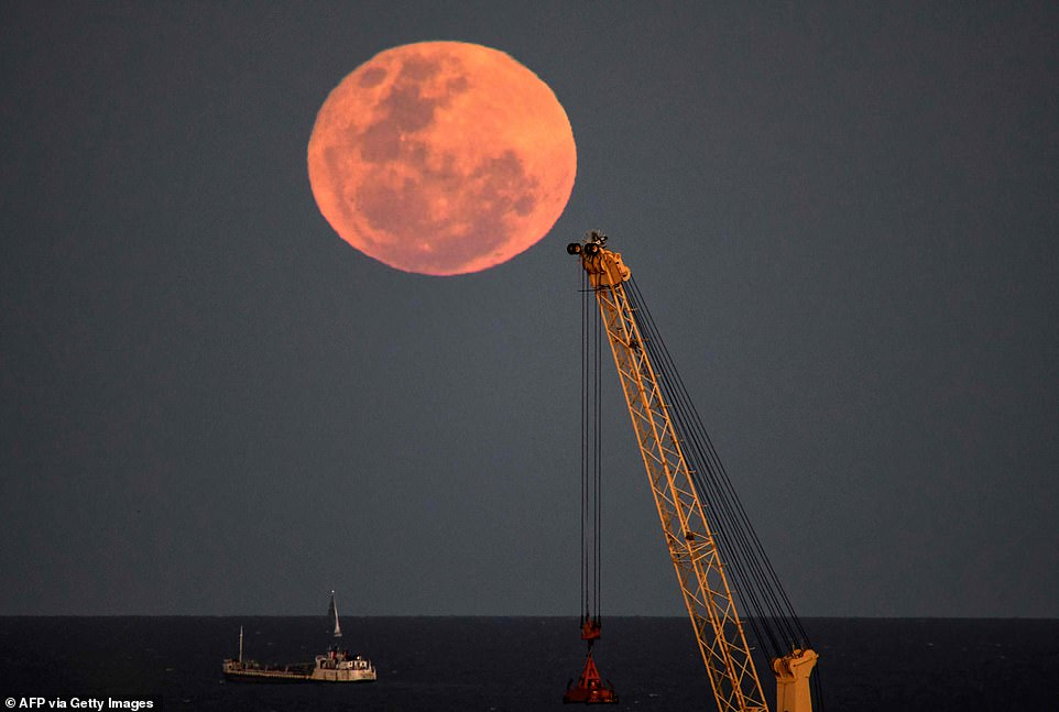 A special moon was seen rising over the La Blatter River in Buenos Aires, Argentina.