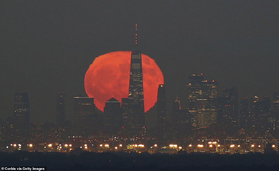 In New York, the moon was seen rising behind Lower Manhattan and a World Trade Center