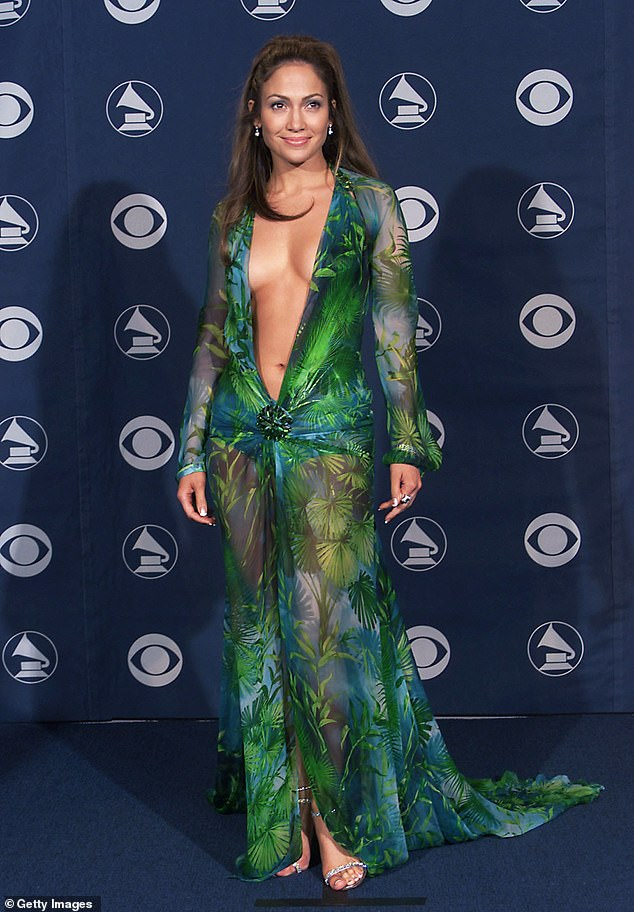 Tribute: Arabella mentions Jennifer Lopez and Versace on her Instagram post - her racing day dress is a tribute to the tropical Versace dress that Jennifer wore to fame at the 2000 Grammy Awards (pictured)