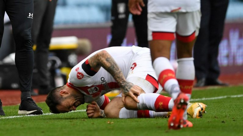 Danny Ings goes to ground clutching his knee