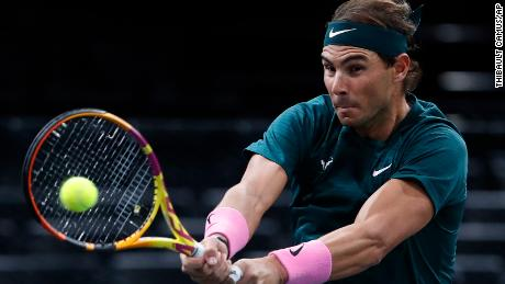 Nadal returns a backhand to Comrade Lopez.