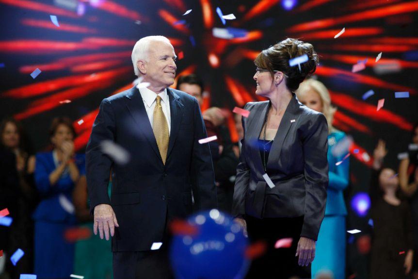 John McCain and Sarah Pauline look at each other