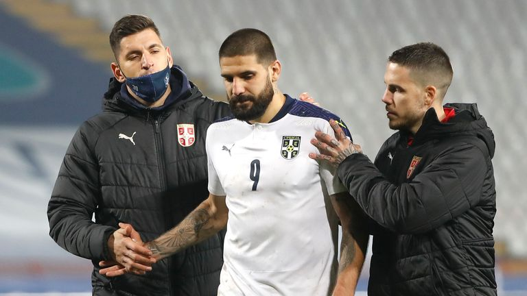 Alexander Mitrovic is comforted after his decisive missed sentence