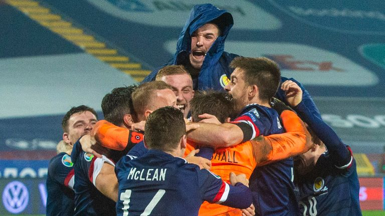 Scotland players celebrate after David Marshall's save victory in a penalty shootout in the UEFA Euro 2020 qualifiers between Serbia and Scotland in Belgrade.