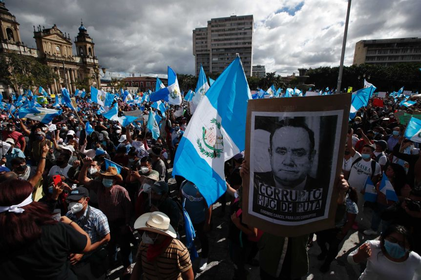 Protesters with flags and placards outside Congress in Guatemala City