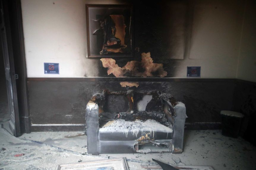 A bed and artwork inside the Guatemala Congress building have been destroyed by fire