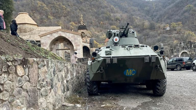 A Russian tank sits in the Tadiwang Monastery