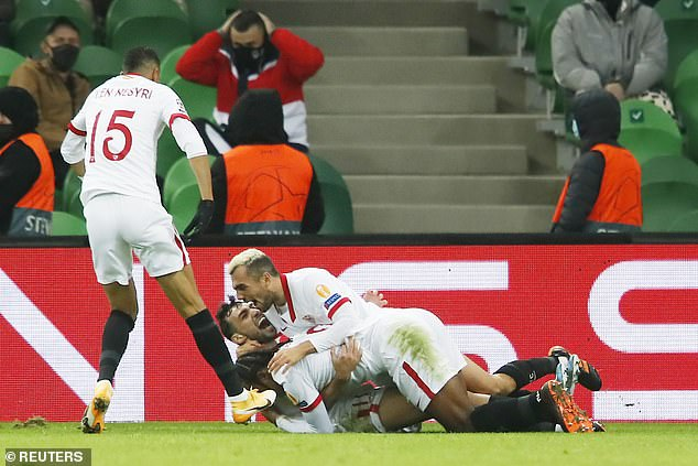 The Sevilla star is being rallied by his cheerful teammates following his last win in Russia