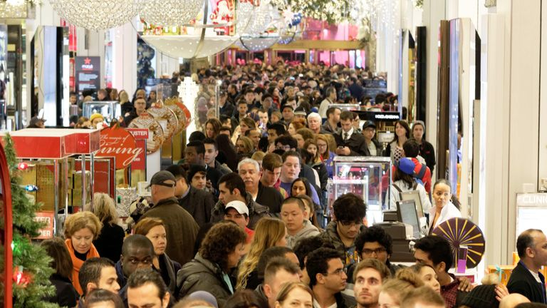 On November 26, 2015, shopkeepers crowd the aisle at the Macy's department store in Herald Square, New York.  Many retail outlets opened their doors to bargain hunters looking for black and silver deals on Thanksgiving Day, a day earlier than the traditional start of the sales season.  .  AFP PHOTO / TREVOR COLLENS / AFP / TREVOR COLLENS (Read TREVOR COLLENS / AFP via Photo Credit Card Images)