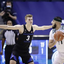 BYU's Matt Harmes (3) defends the Utah Valley's Fardows Imak (11) as he handles the ball as the Cooks win 82-60 against the Wolverines at the Marriott Center in Provo on Saturday, November 28, 2020.