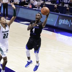 Jamie Overton, 22, of the Utah Valley, shoots BYU's Brandon Avert (4) as the Cooks win 82-60 against the Wolverines at the Marriott Center in Provo on Saturday, November 28, 2020.