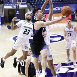 BYU's Alex Barcello (13) showed tight defense when the Cooks won 82-60 against the Utah Valley Wolverines at the Marriott Center in Provo on Saturday 28 November 2020.