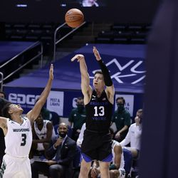 When the Cooks beat the Wolverines 82-60 at the Marriott Center in Provo on Saturday, November 28, 2020, BYU's Alex Barcello (13) puts a shot from a corner into Blaze Nealt (3) of Utah Valley.