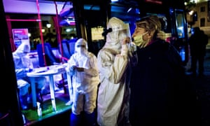 A drug tests a woman for the corona virus during a nationwide test on October 31, 2020 in Bratislava, Slovakia.