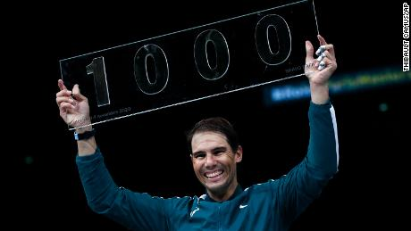 Nadal poses with his 1000th victory trophy.