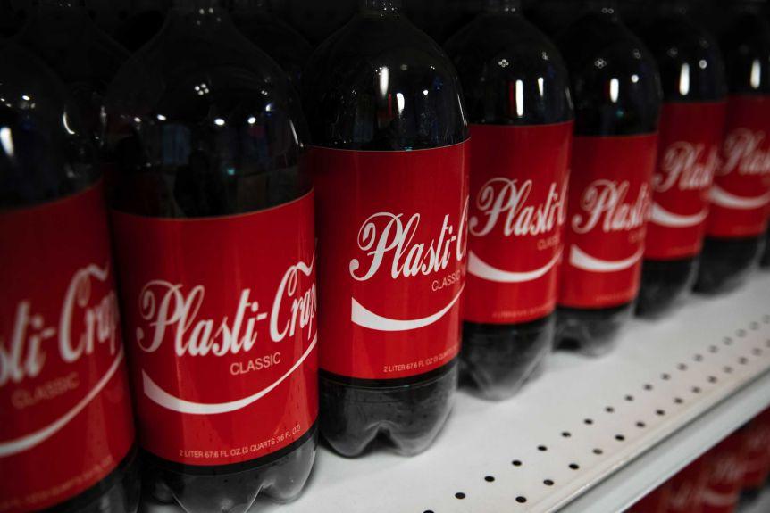 Black plastic bottles covered with Coca-Cola-SQ labels 'Plastic-Crop Classic'