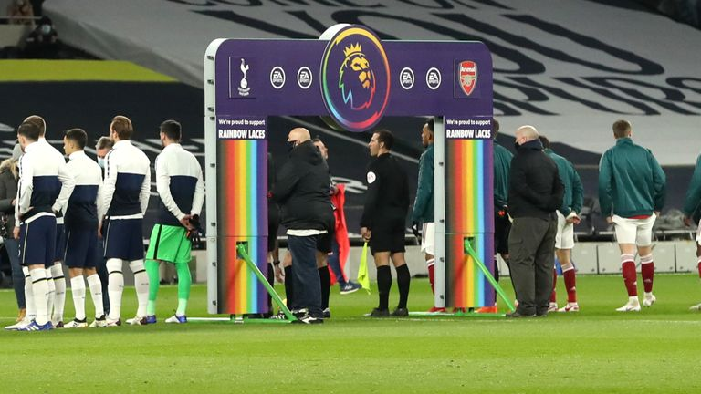 LONDON, England - December 06: Two sets of players line up in front of a handshake board at Stonewall Rainbow Lace Branding in support of their campaign ahead of the Premier League match at the Tottenham Hotspur Stadium between Tottenham Hotspur and Arsenal.  December 06, 2020 in London, England.
