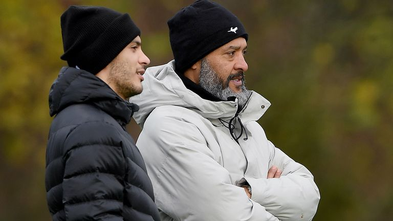 Ral Jimenez watches the wolves train with Nuno Esprito Santo