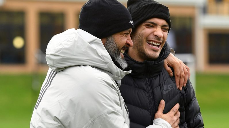 Raul Jimenez laughs with Nuno Espirito Santo as he visited Wolves' training ground following his discharge from hospital after suffering a fractured skull against Arsenal