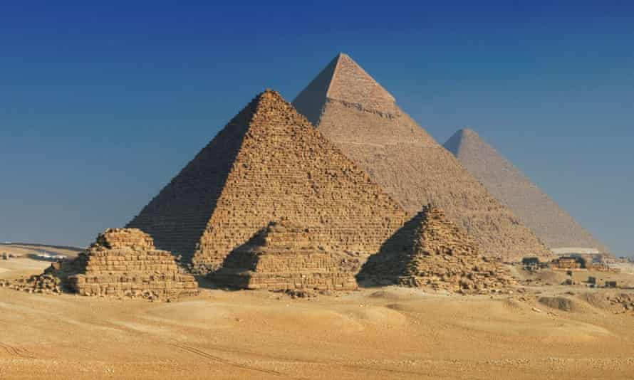 Pyramids of Giza, Cairo, Egypt.  The Great Pyramid is in the center.