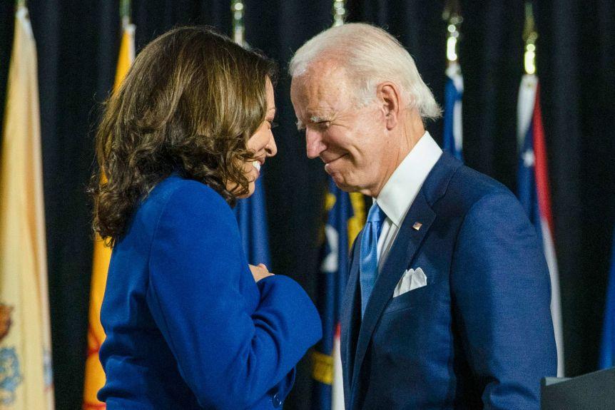 Kamala Harris and Joe Biden smile at each other