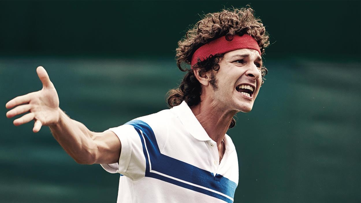 A person (Shia Lafoof) dressed as a tennis player, on a tennis court, is angry.