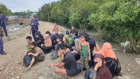 Dozens of refugees stranded at sea on isolated island