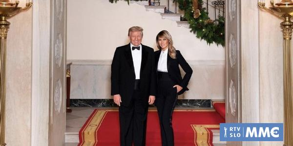 Donald and Melania Trump in last Christmas portrait in matching tuxedos