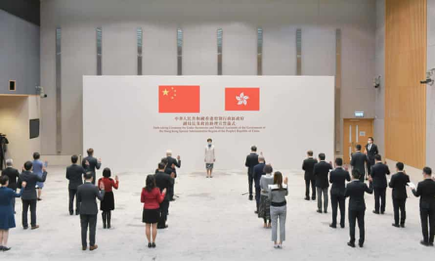Gary Lam, Hong Kong's chief executive, oversees the swearing - in ceremony for lower secretaries and political aides.