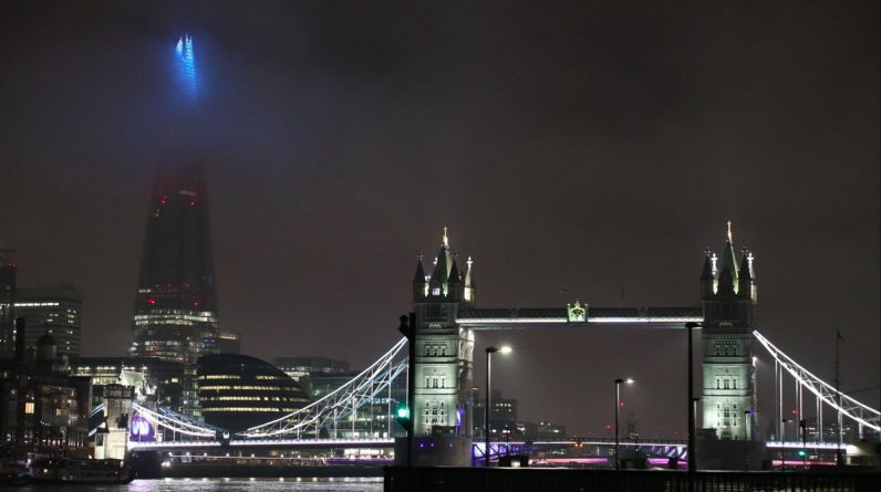 London signs light up blue to celebrate NHS heroes