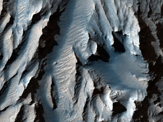 Titanium Sasma (part of the Walls Marineris on Mars) runs along diagonal sedimentary lines, which, according to live science, may refer to ancient freezing and thawing cycles.