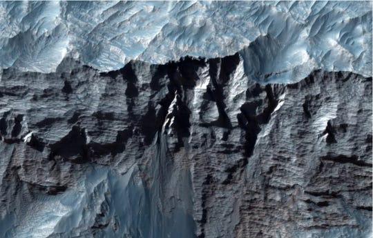If you look closely at the Wallace Marineris of Mars, the largest valley in the solar system.
