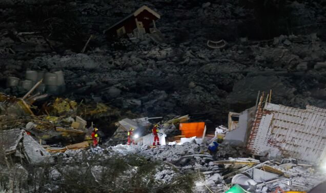 "Seventh body found in landslide.  ""We don't know if we're walking on the ground."""