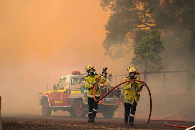 This photo, provided by the Fire and Emergency Department, shows firefighters trying to control a wildfire near Worlow, northeast of Perth, Australia, on February 2.