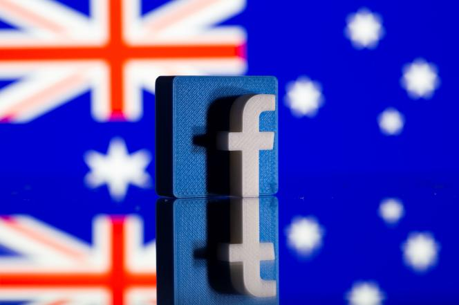 Facebook 3D logo in front of the Australian flag on February 18, 2021.