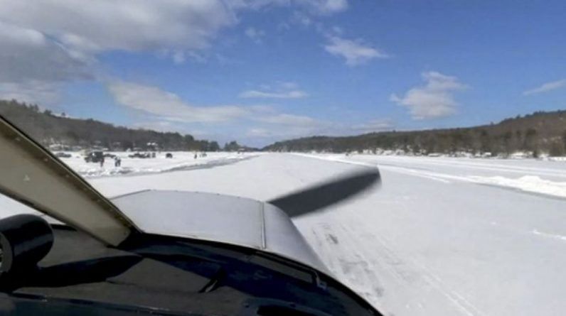Video.  Unusual images of a plane landing on a frozen lake in the United States.  How much does the ice layer measure?