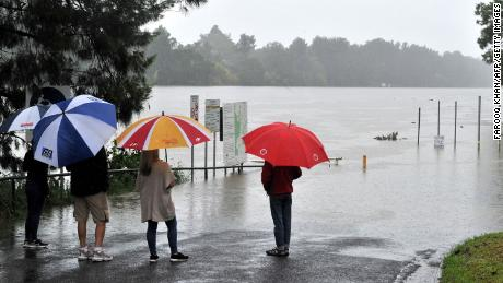 Residents notice a swollen Nepalese river during heavy rains on March 20 in western Sydney.