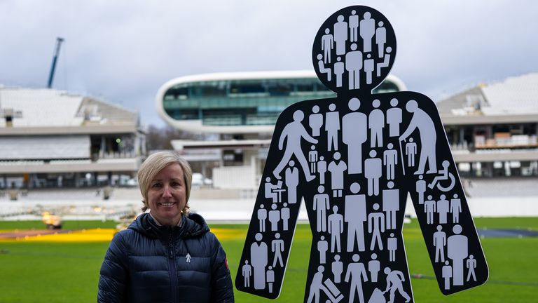 Lauren Clark, wife of Bob Willis, stands near the UK symbol of prostate cancer