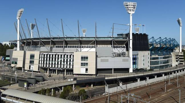 A positive audience at the Melbourne Stadium, thousands urged people to isolate themselves