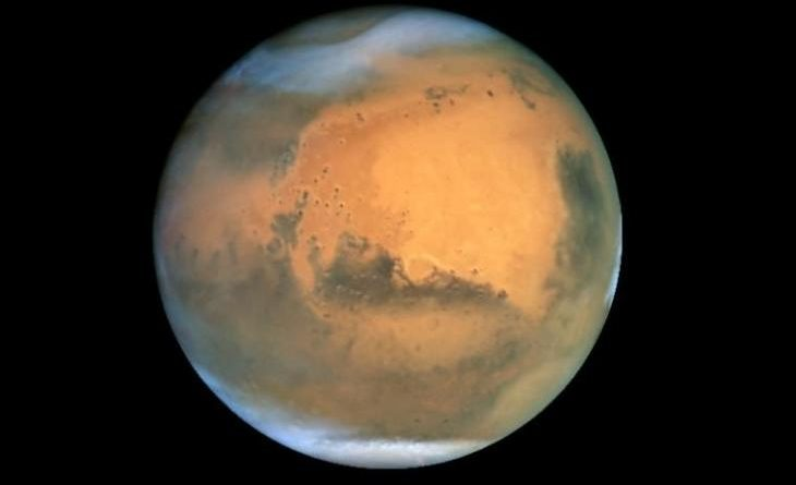 Is there evidence of volcanoes, or is Mars more inhabited?